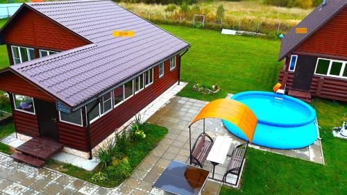 A view of the pool at Домик с баней в деревне. or nearby