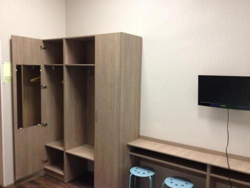 A television and/or entertainment center at Mini-hotel Gorbunki