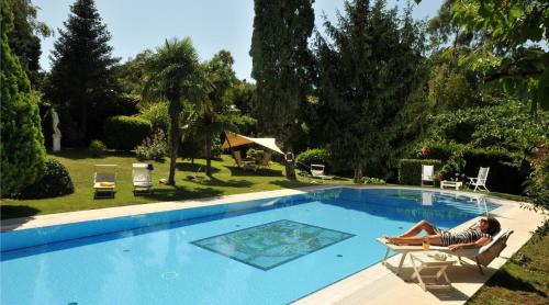 The swimming pool at or near Hotel Villa Clementina