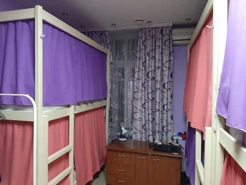 A bunk bed or bunk beds in a room at Hostel Salute