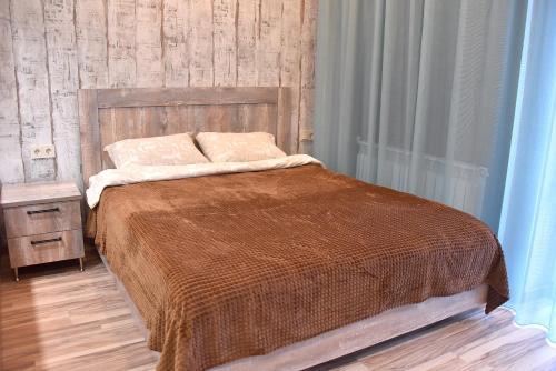 Кровать или кровати в номере Allianceapart на Белинского 30