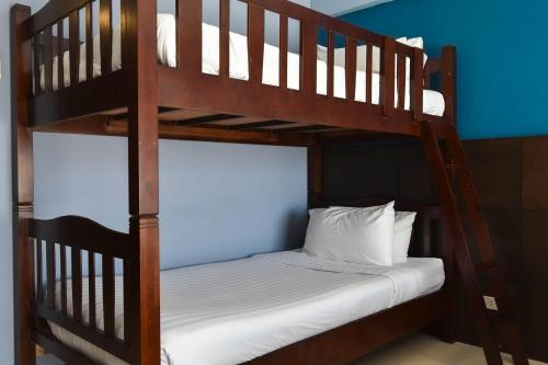 A bunk bed or bunk beds in a room at Aonang Buri Resort