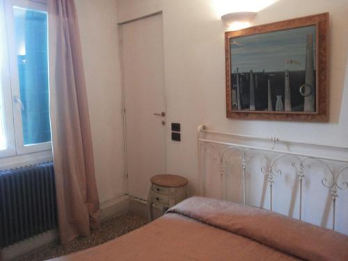 Cama ou camas em um quarto em Hotel Antico Capon
