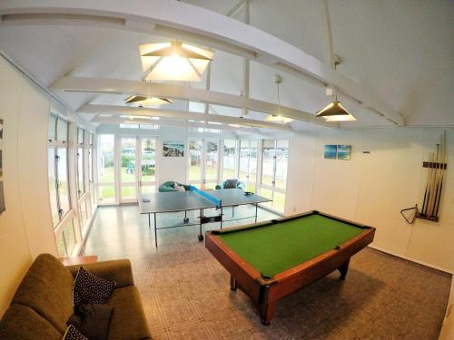 A billiards table at Chamberlain House - 3 bedroom house by Manly beach