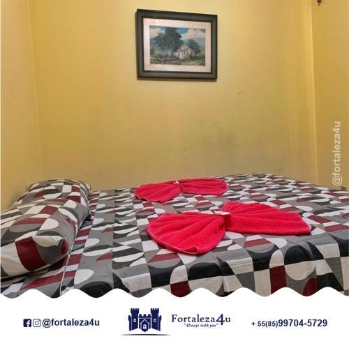 A bed or beds in a room at Flat em Meireles perto da Feirinha