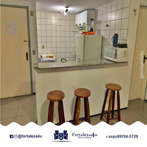 A kitchen or kitchenette at Flat em Meireles perto da Feirinha