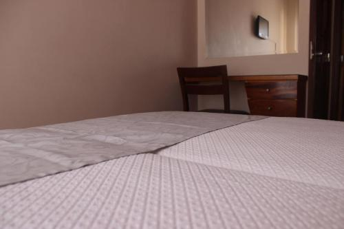 A bed or beds in a room at Hotel Afonso III - Eurosun Hotels