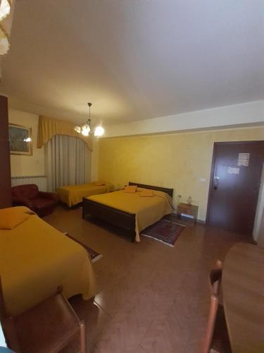 Letto o letti in una camera di Hotel Ristorante Supersonik