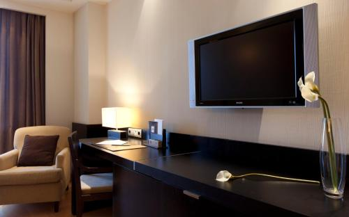A television and/or entertainment center at Hotel Nelva