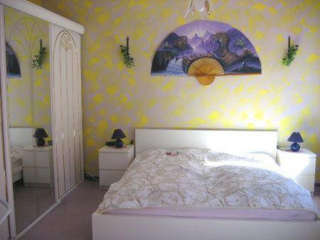 Ein Bett oder Betten in einem Zimmer der Unterkunft Wohnung Elbmündung