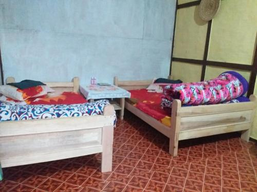 A bed or beds in a room at Churibotay homestay