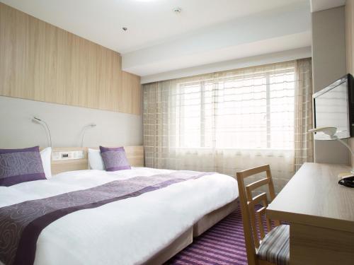 Letto o letti in una camera di Hotel Keihan Kyoto Grande