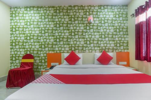 A bed or beds in a room at Bhitarkanika Crocodile Resort