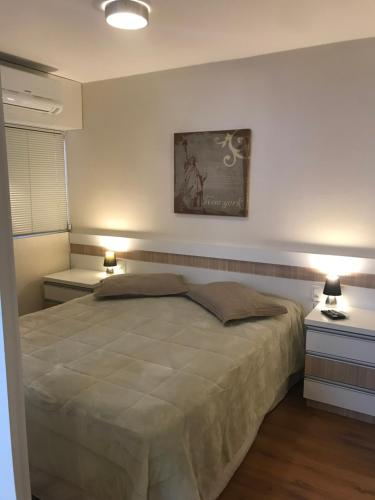 A bed or beds in a room at Wall Street Flat Service