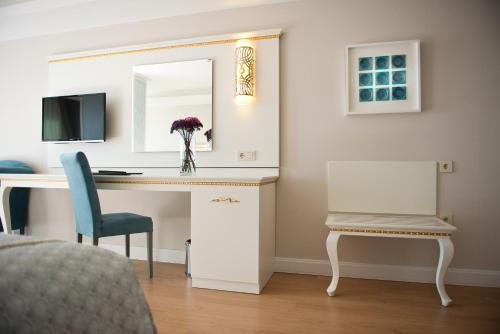 A television and/or entertainment center at Prime Boutique Hotel