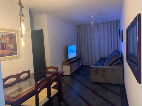 A seating area at Apartamento Arraial Home