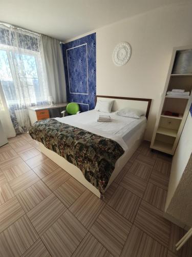 Кровать или кровати в номере Apartments Zvezda-Vokzal-Centre