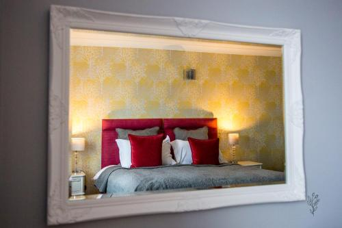 A bed or beds in a room at Cricklade House Hotel, Sure Hotel Collection by Best Western