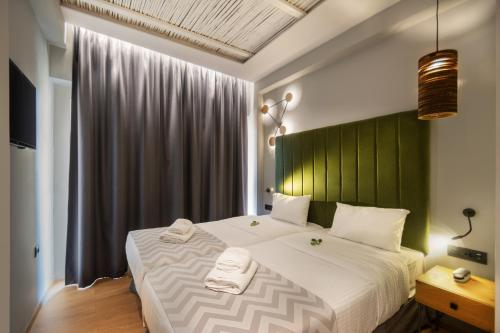 A bed or beds in a room at Palmera Beach Hotel & Spa