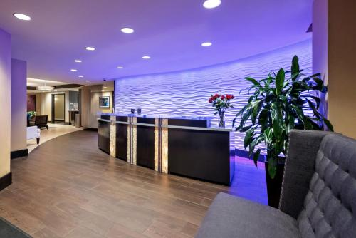The lobby or reception area at Artmore Hotel