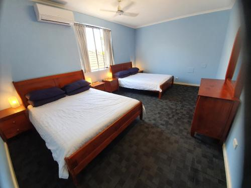 A bed or beds in a room at Bondi Beach Backpackers