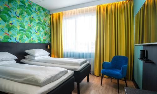 En eller flere senger på et rom på Thon Hotel Alta