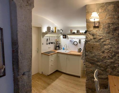 Küche/Küchenzeile in der Unterkunft Landappartement Stritter