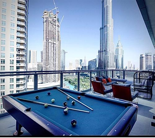 A billiards table at Downtown Al Bahar Apartments