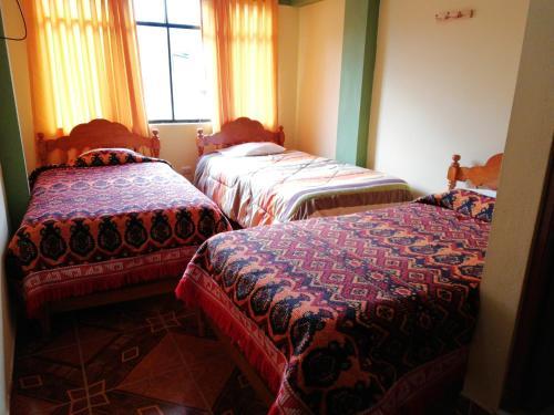 A bed or beds in a room at Scheler Artizon Trek Hostel