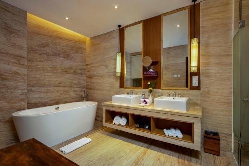 A bathroom at Grand Inna Kuta