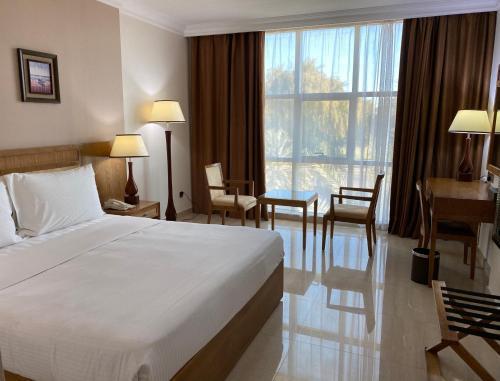 Кровать или кровати в номере City Center Hotel