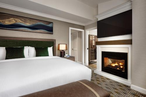 A bed or beds in a room at Fairmont Chateau Whistler