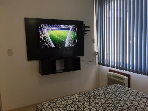 A television and/or entertainment centre at Casa da Brigite