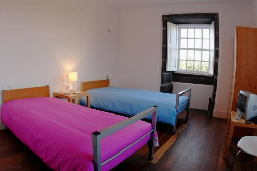 A bed or beds in a room at Azores Youth Hostels - Pico