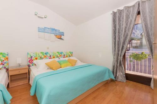 Postel nebo postele na pokoji v ubytování Apartments Luce