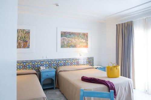 Cama o camas de una habitación en Playa de la Luz