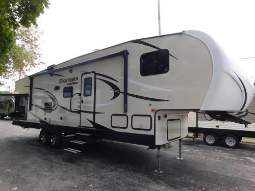 Air conditioned RV trailer in quiet caravan site