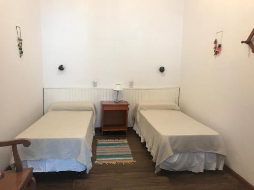 Una cama o camas en una habitación de Posada Casa de Borgoña