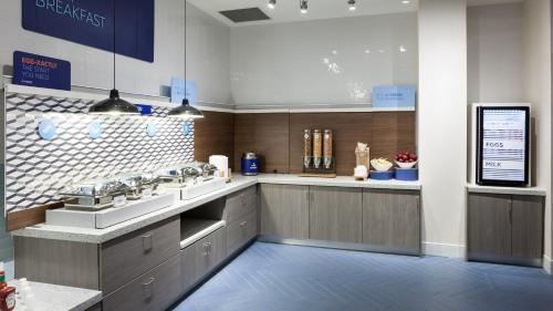 A kitchen or kitchenette at Holiday Inn Express & Suites - Orlando At Seaworld, an IHG Hotel
