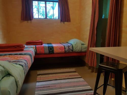 A bed or beds in a room at The Cell Block Backpackers