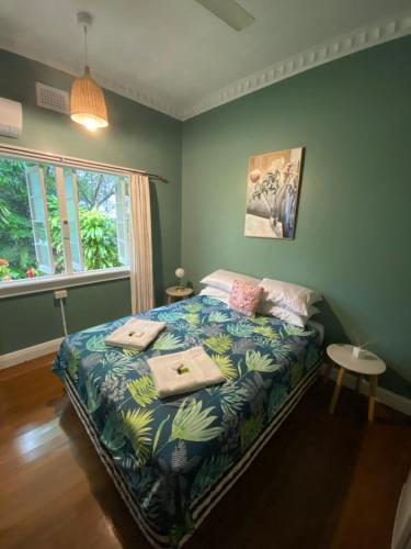 A bed or beds in a room at Babinda Quarters