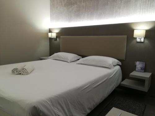 Letto o letti in una camera di Poggio Hotel