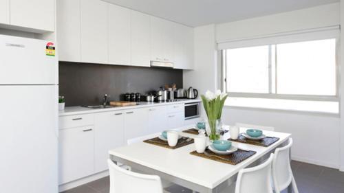 Кухня или мини-кухня в Unilodge @ UC Short Stays