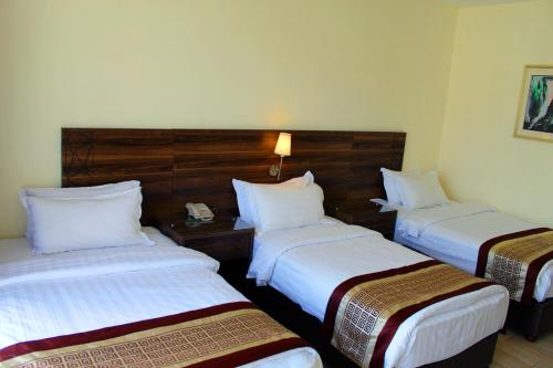 A bed or beds in a room at Lacosta Hotel