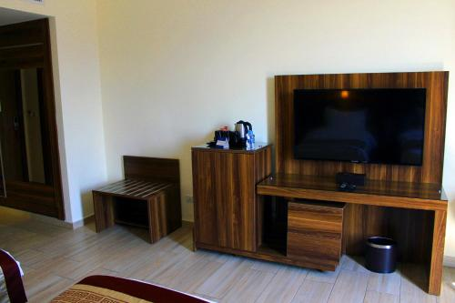 A television and/or entertainment center at Lacosta Hotel
