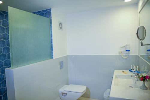 Ванная комната в Brayka Bay Reef Resort