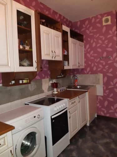 A kitchen or kitchenette at Апартаменты на Выхино