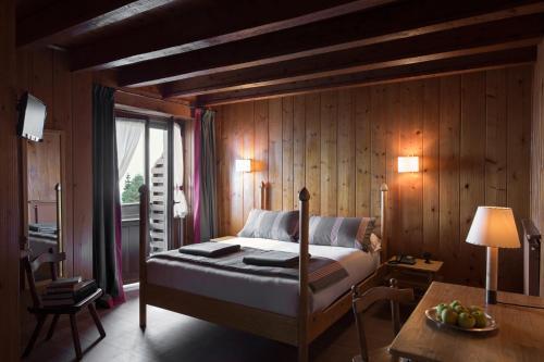 Letto o letti in una camera di Albergo Ristorante Bucaneve