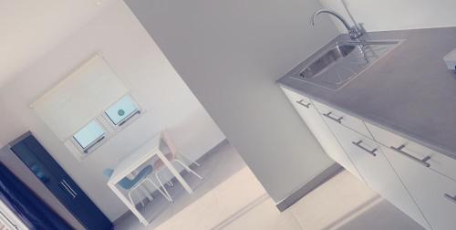 A cozinha ou cozinha compacta de Apartment Curacao