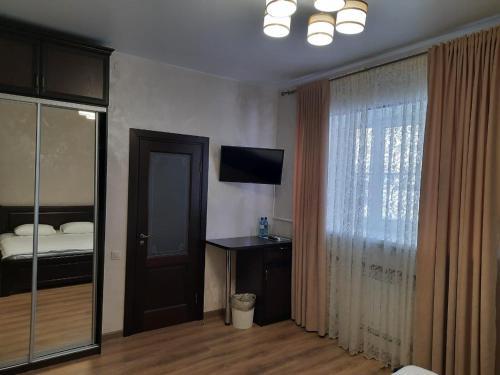 Телевизор и/или развлекательный центр в Гостиный Двор Алтай